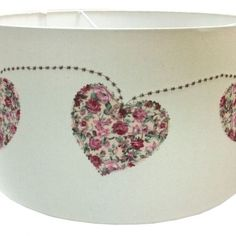 Love is in the air - literally with this handmade lampshade. 7 vintage fabric hearts are appliqued onto the fabric. Sent with love from Cornwall.