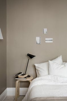 Using a small stool as a nightstand in the bedroom   Residence