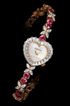 DeLaneau's Delicate Heart jewellery watch is gem-set with baguette-cut diamonds, intense-pink heart-shaped sapphires and 40 navette diamonds.