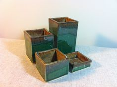 Ceramic set of 4 small containers