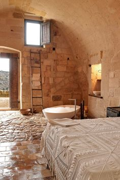 Sextantio Le Grotte Della Civita - Matera, Italy - Romantic candlelit rooms are carved out of rock at this stunning cave hotel in Sassi di Matera.