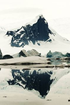 reflection in a lake: snowy mountain | winter . Winter . hiver | @ wit & delight journal | | See more about snowy mountains, mountains and lakes.