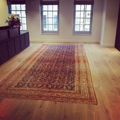 Antique Persian Ferraghan Rug In the reception of a commercial project we've been working on in Marylebone, London. #rug #rugs #persianrug #persian #interiors #interiordesign #design #oldandnew #antique #antiquerug #london #office #luxury