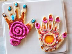 Hand Cookies : Ree's daughter and her friends let the shape of their hands dictate the shape of these orange-laced cookies. Afterward, they decorated them with colorful glazes and edible decorations.