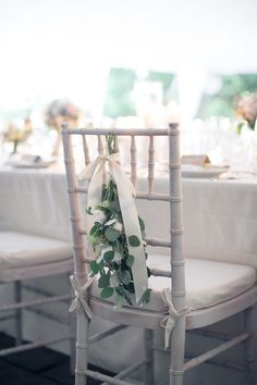 a great way to decorate the back of a chair  Photography By / isabelleselbyphotography.com, Planning By / eapweddings.com, Floral Design By / sprouthome.com