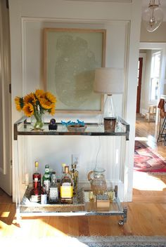 Chrome and lucite bar cart. Love.
