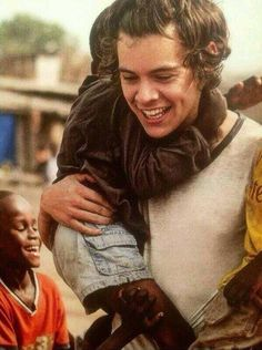 Harry Styles with some child in Ghana