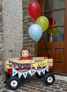 So many amazing ideas here!  Wagon with birthday banner, 12 month banner, mason/jelly jars for candy, watermelon and pineapple for fruit, tissue pom poms and more!!