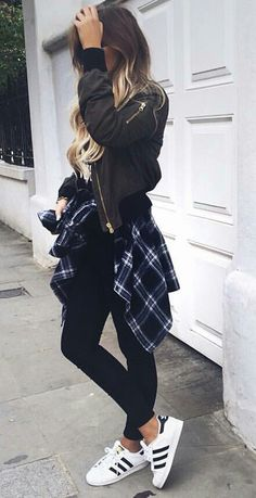 Image via We Heart It #blackjeans #whitesneakers #plaidshirts #blackbomberjacket #blondecurledhair