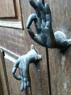 Cool - Buddha's hands on the door.