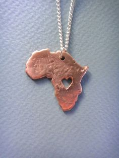 Handmade copper metal pendant of Africa with a by StudioandSketch, £25.00