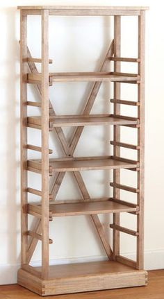 World Market Campaign bookshelf is only $279 dollars (put casters on the bottom?