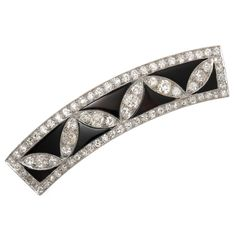 1920s Onyx Diamond Platinum Hair Barrette. Circa 1920s Platinum, Diamond and Onyx Hair Barrette, measuring 2 3/8 inch in length and 1/2 inch wide. Set with Old Mine Cut Diamonds that are very White and clean and total over 4 Carats. Further set with alternating Black Onyx.