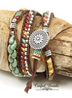 A stylish Bohemian leather wrap bracelet. This bracelet features Czech glass beads in Southwest colors. It utilizes superduos, diamond duos, zoliduos, and Czech Hawaiian flower beads. They have all been stitched onto 1.5mm natural red brown leather and have been interspersed with