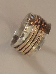Sterling silver spinner ring with gold bands custum made by TrailerTrashJewelry1 on Etsy https://www.etsy.com/listing/248595193/sterling-silver-spinner-ring-with-gold