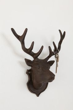 iron deer head...i want these as hand towel holders in one of our bathrooms!