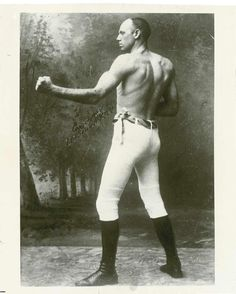 "Robert James ""Bob"" Fitzsimmons (May 26, 1863 – October 22, 1917), was a British boxer who made boxing history as the sport's first three-division world champion. He also achieved fame for beating Gentleman Jim Corbett, the man who beat John L. Sullivan, and is in The Guinness Book of World Records as the Lightest heavyweight champion. Nicknamed Ruby Robert or The Freckled Wonder, he took pride in his lack of scars, and appeared in the ring wearing heavy woollen underwear to conceal the disparity between his trunk and leg-development."
