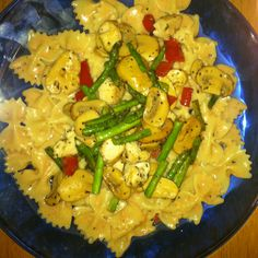 Farfalle pasta in a parma rosa sauce with asparagus, red pepper, mushrooms and chicken. Yum