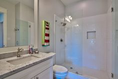 Clean and cool bathroom - Destin, FL. http://chimarconstruction.com/portfolio_page/the-brownstones-at-kelly-plantation/