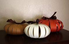 Adorable paper pumpkin tutorial. Would make for some awfully stylish Thanksgiving decor...