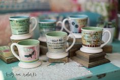 We love Kelly Rae Roberts new line of Mugs. They are 14oz with a nice sturdy base.