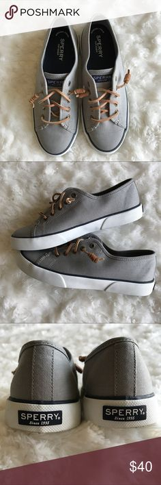 Grey Sperry Canvas Sneaker Women's Seacoast Canvas Sneaker. Vulcanized construction with secure bond between upper and outersole. Lace to toe with signature  rawhide lacing for easy on/off wearing. Non-marking rubber outsole with razor cur Wave-Siping for ultimate wet/dry traction. Sperry Shoes Sneakers