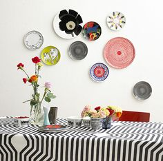 I am loving everything about Marimekko ! Marimekko Corporation is a leading Finnish textile and clothing design company. The company desi. Decor, Hanging Plates, Plate Collage, Plates On Wall, Marimekko, Plate Display, Plates Diy, Plate Hangers, Decorative Plates
