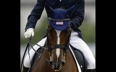 Jan Ebeling, of the United States, rides his horse Rafalca in the equestrian dressage competition at the 2012 Summer Olympics, Tuesday, Aug. 7, 2012, in London. Rafalca is co-owned by Ann Romney, the wife of U.S. Republican presidential candidate Mitt Romney