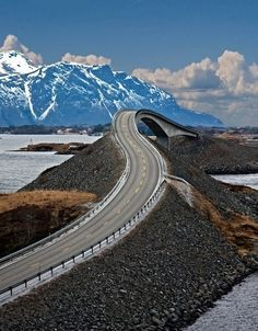 Storseisundet Bridge, part of the Atlantic Road in Norway...built high enough for the waves to crash through.