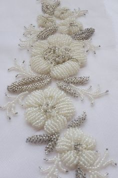 Hand Embroidered Motif with raised ivory and silver beads Pearl Embroidery, Zardozi Embroidery, Bead Embroidery Patterns, Flower Embroidery Designs, Hand Embroidery Stitches, Embroidery Jewelry, Embroidery Techniques, Motifs Perler, Beadwork Designs