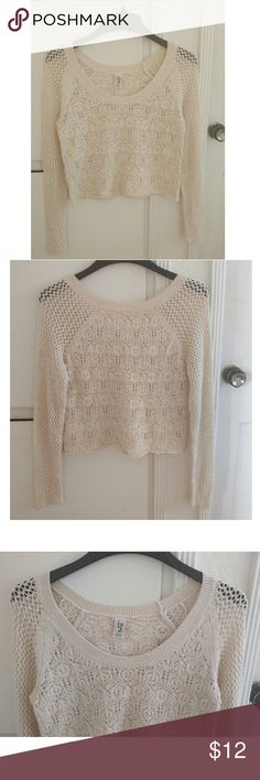 Crochet cropped sweater Beautiful cream colored sweater perfect to layer over camis...or even throw over your bikini on balmy summer nights. So cute with jeans and flats as well. Worn once. Sweaters Crew & Scoop Necks