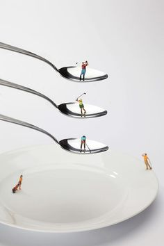 People Playing Golf On Spoons Little People On Food Painting by Paul Ge
