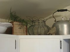 Decorating above the kitchen cabinets w/ kitchen antiques