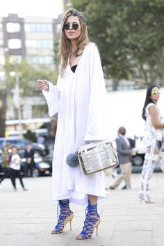 """NYFW Street Style Day 1: Her tunic might say """"laid-back,"""" but those heels say """"Fashion Week"""" — with a capital """"F."""""""