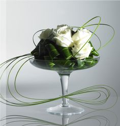 Simple centerpiece, small but with nice fluid movement. Although not as elegant, ivy would also work.