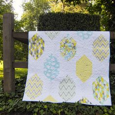 Use pieced fabric?  Thin strips done in strata?  Spaced Out Quilt