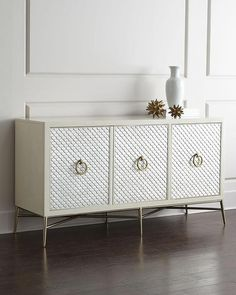 Storage Furniture - Stunningly beautiful and fashionably contemporary, this console provides storage space in any room. Ventilation holes and a wire management cutout make it functional as an entertainment chest as well.