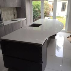 This is the Bianco De Lusso Urban Quartz situated on top of the kitchen island. This is our popular white quartz, with small grey flecks and diamante sparkles. Central Island, White Quartz, Granite, Sparkles, Office Desk, Kitchen Island, This Is Us, Urban, Popular