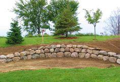 boulder wall landscape for our front yard....