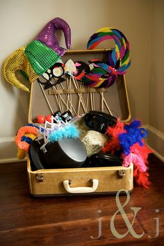 Great idea for photo booth props. I like the tabs they added to the suitcase lid to hold the sticks. I can use my treasure chest! Wedding Photography Props, Wedding Props, Our Wedding, Wedding Themes, Wedding Album, Wedding Outfits, Wedding Attire, Wedding Dresses, Wedding Ceremony