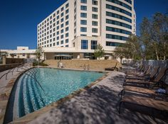 Come unwind and take a dip in our pool during your stay! #Hiltongranitepark #hiltondpgp #travel #plano #dallas #texas