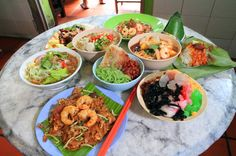 Examples of Penang most famous hawker dishes; char koay teow, ais kachang, laksa, Nasi lemak, Mee goreng,,curry mee.........