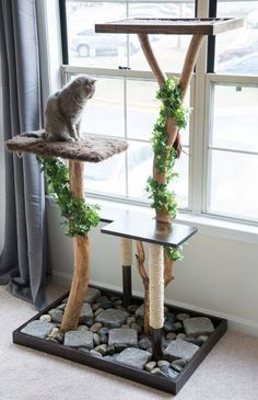 Make a homemade cat condo! Learn how to make an aesthetically pleasing DIY cat tree using Ikea tables, fabric, and a few other supplies. Diy Jouet Pour Chat, Cat Tree Designs, Diy Pet, Cat Tree Plans, Cat Climber, Diy Cat Tree, Cat Towers, Cat Scratcher, Cat Room