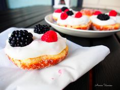 Crispy donut from grill with blueberry and vanilla filling topped with fresh blackberries and rasberries.
