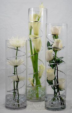 For a Modern Party Spider mums Calla Lilies Roses LED Lights are in the Pebbles at the bottom of the vases Flowers by Aprils Garden www durangof is part of Wedding decorations - Wedding Centerpieces, Wedding Table, Wedding Decorations, Fake Flower Centerpieces, Decoration Evenementielle, Flower Decorations, Spider Mums, Deco Floral, Flower Vases