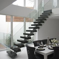 straight staircase design for resident and commercial building,with contemporary ideas.Demax Arch supply wood ,stainless and glass for staircase element. Staircase Design Modern, Home Stairs Design, Modern Stairs, House Design, Steel Stairs Design, Carpet Staircase, Wood Staircase, Floating Staircase, Spiral Staircases