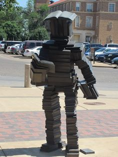 "This work is called ""Read Reader"" by Terry Allen. The bronze statue can be found at Texas Tech University, Lubbock, TX Cool Books, I Love Books, Books To Read, Big Books, Texas Tech University, Reading Art, Reading Books, Book Sculpture, Altered Books"