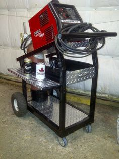 MIG Cart by ecm_this -- Homemade MIG cart adapted from a BBQ cart and incorporating diamond plate shelves and drawers. http://www.homemadetools.net/homemade-mig-cart-2