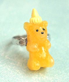 this adorable ring features a handmade honey bear bottle made from polymer clay…