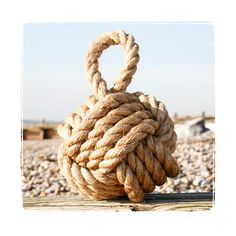 Nautical Interiors - this knot originally was used to keep ships doors open or closed as a counter weight. The jute was knotted around a cannon ball, or a round rock. You can use it for a paperweight, a door knocker, or an accent. Next to your glass fisherman's floats, of course!